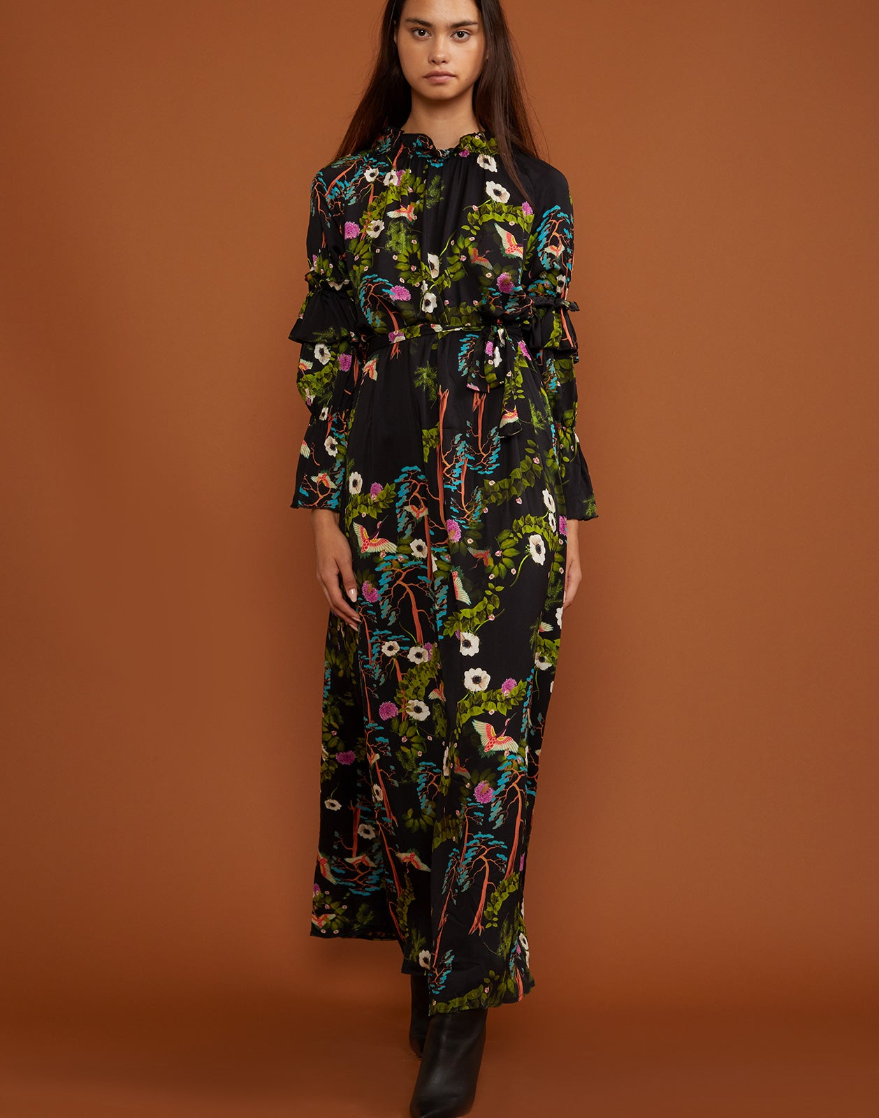 Full front view of the Allegra dark floral print dress with ruffle sleeves.
