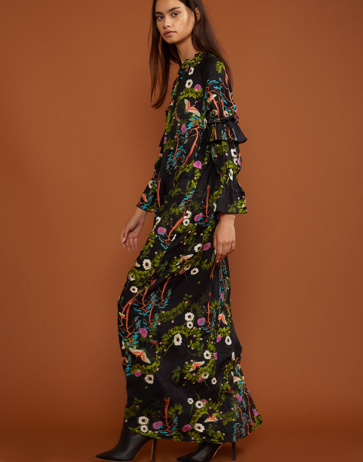Side view of the Allegra ruffle sleeve maxi dress in dark floral print.