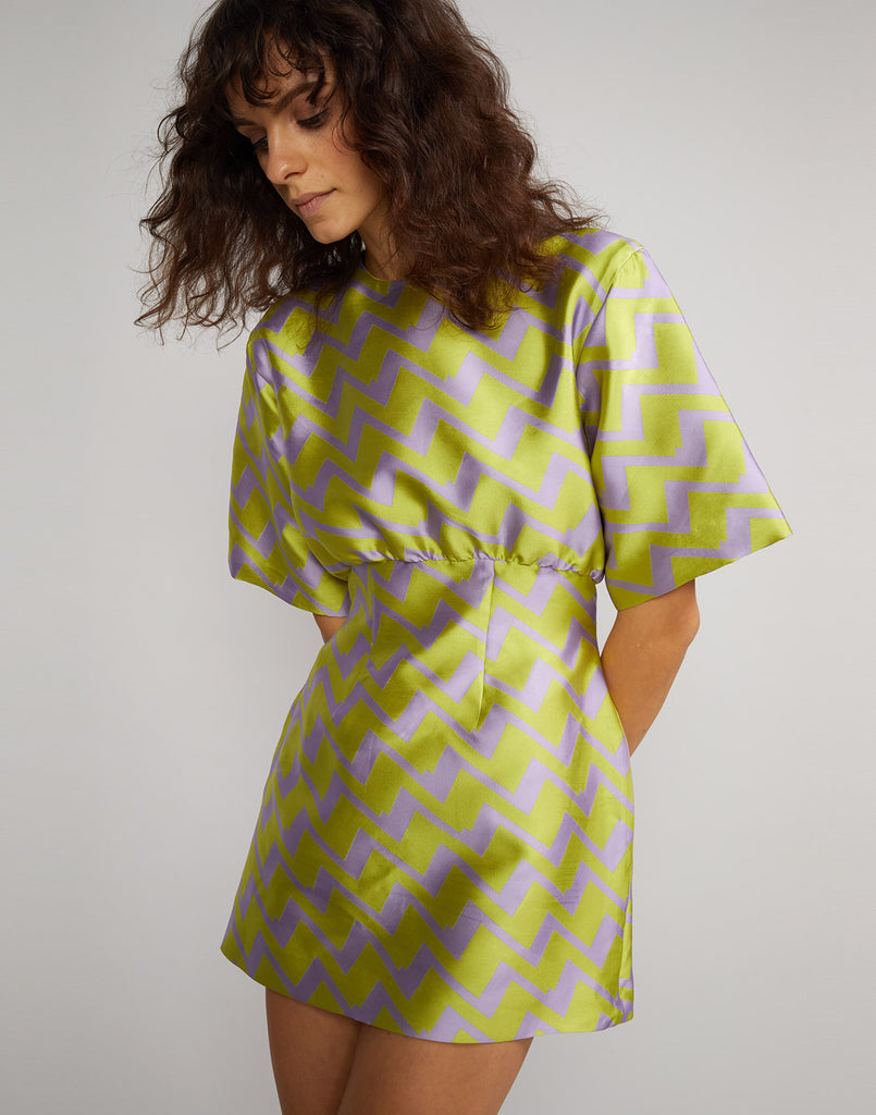 1e994a7ed532 Close view of the Evanston Zig Zag Brocade Mini Dress in lavender and lime  ...