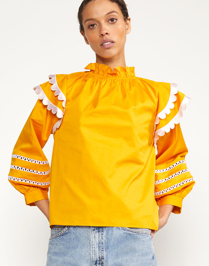Close up view of Elia Scallop Embroidered Top with three quarter puff sleeves
