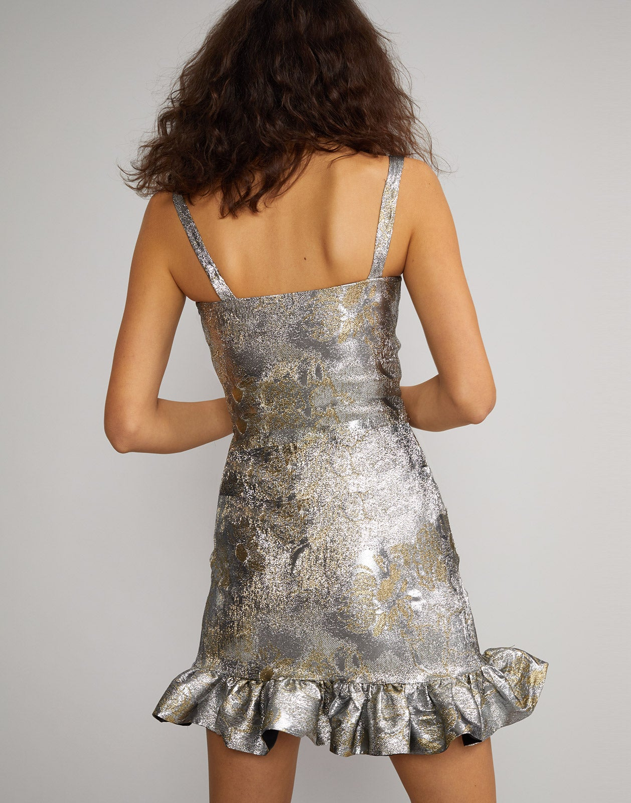 Back view of model wearing Gold Coast Metallic Brocade mini dress.