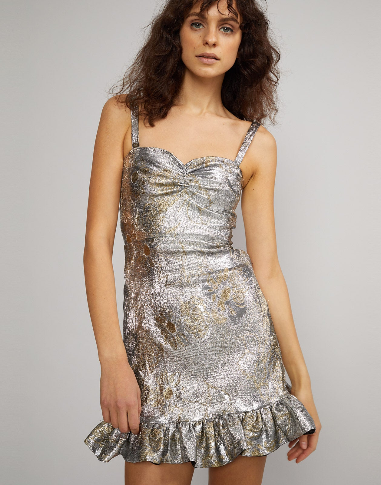 Front close up view of model wearing Gold Coast Metallic Brocade mini dress.