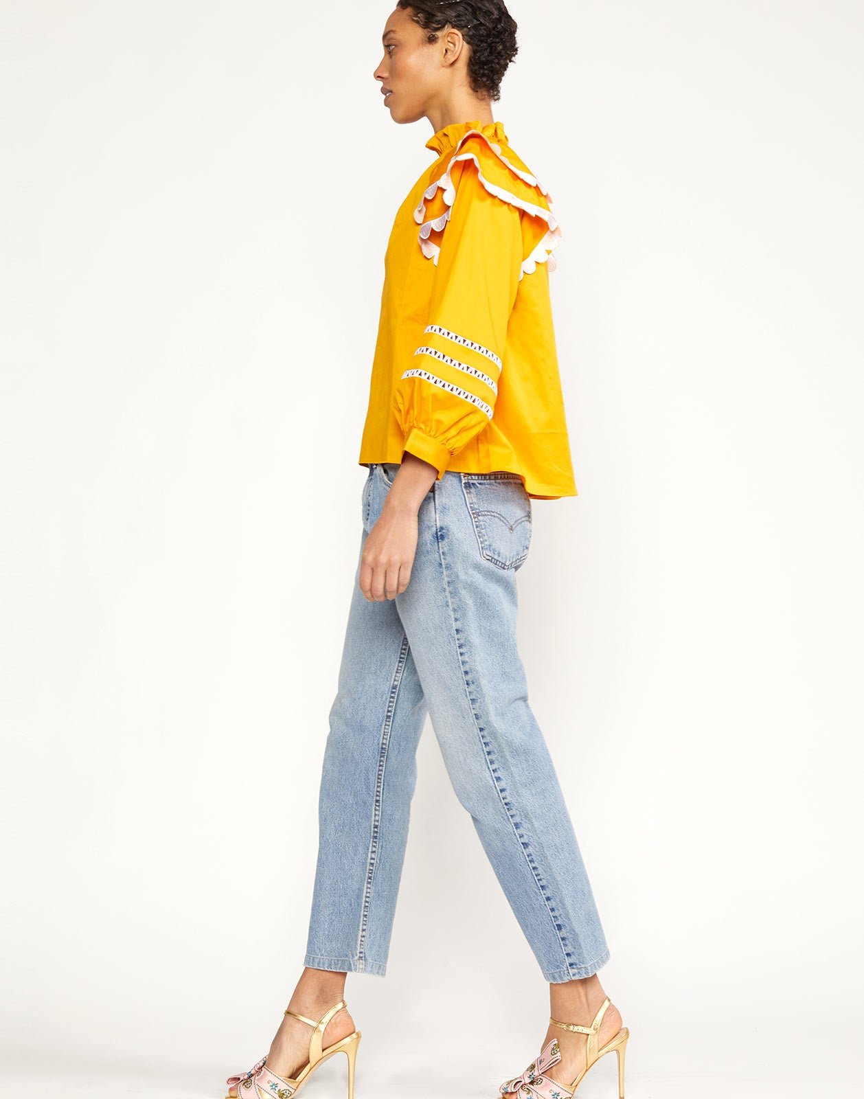 Side view of Elia Scallop Embroidered Top with wide hem and relaxed silhouette