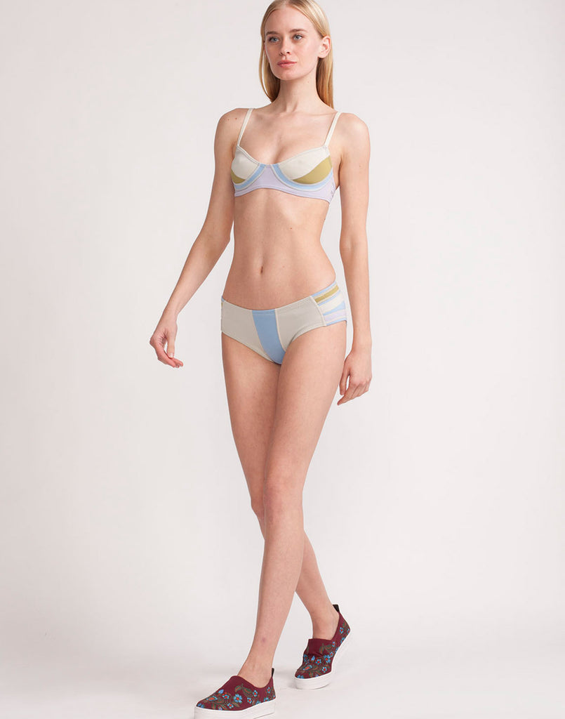 Front view of model wearing Colorblock bikini bottom in silky white.