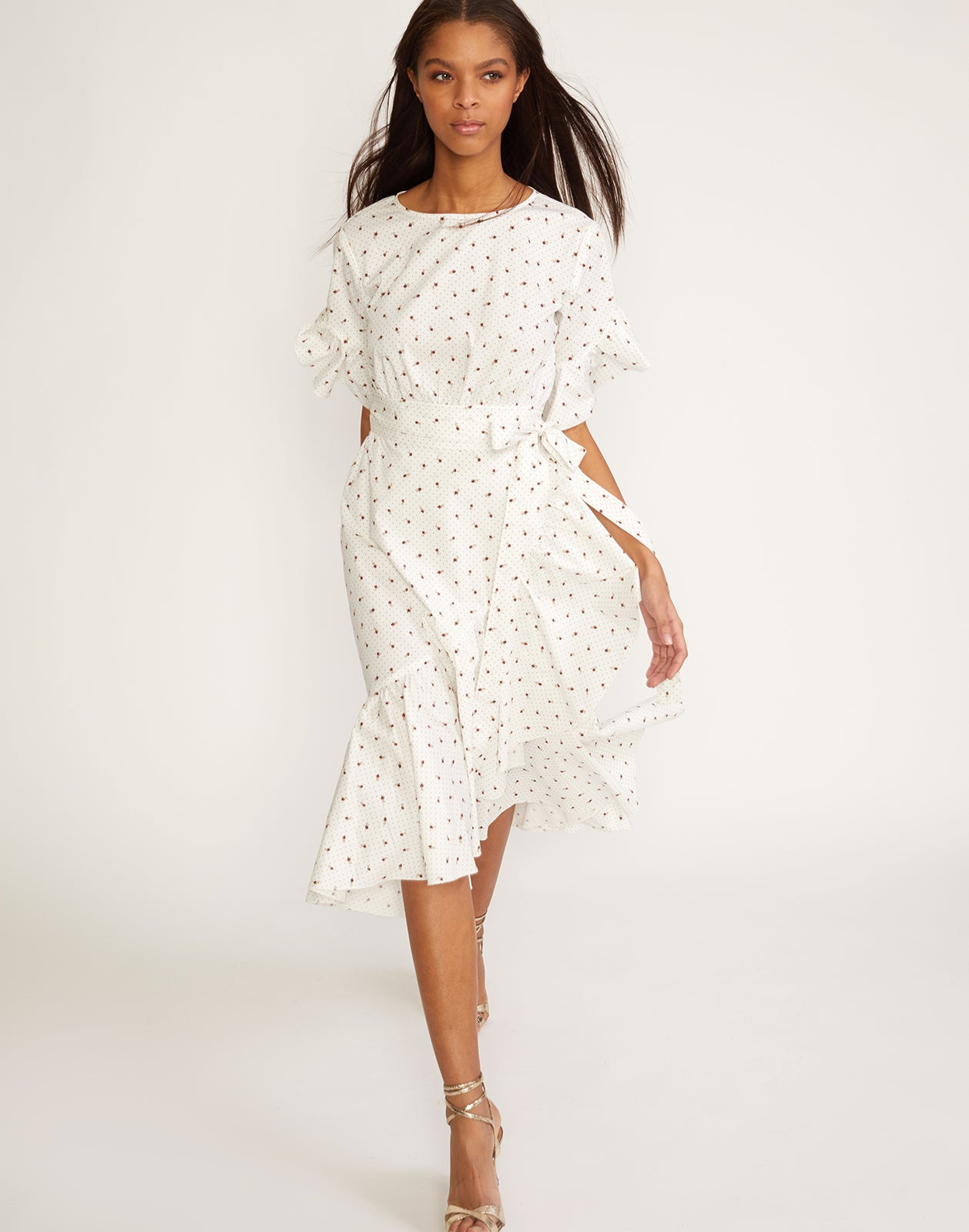 Front view of the polished cotton ruffle wrap dress in mini rosebud print.