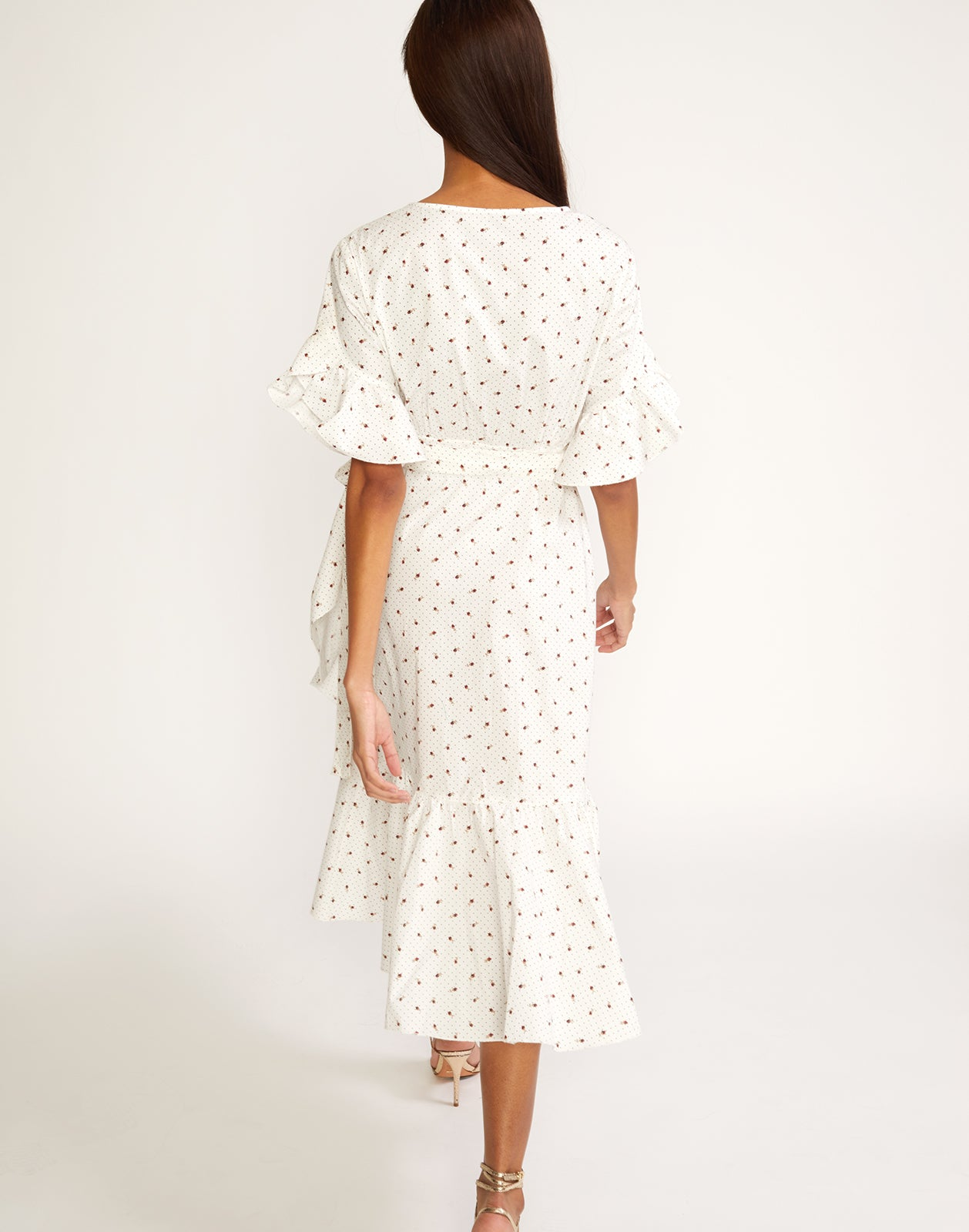 Back view of the polished cotton ruffle wrap dress in mini rosebud print.