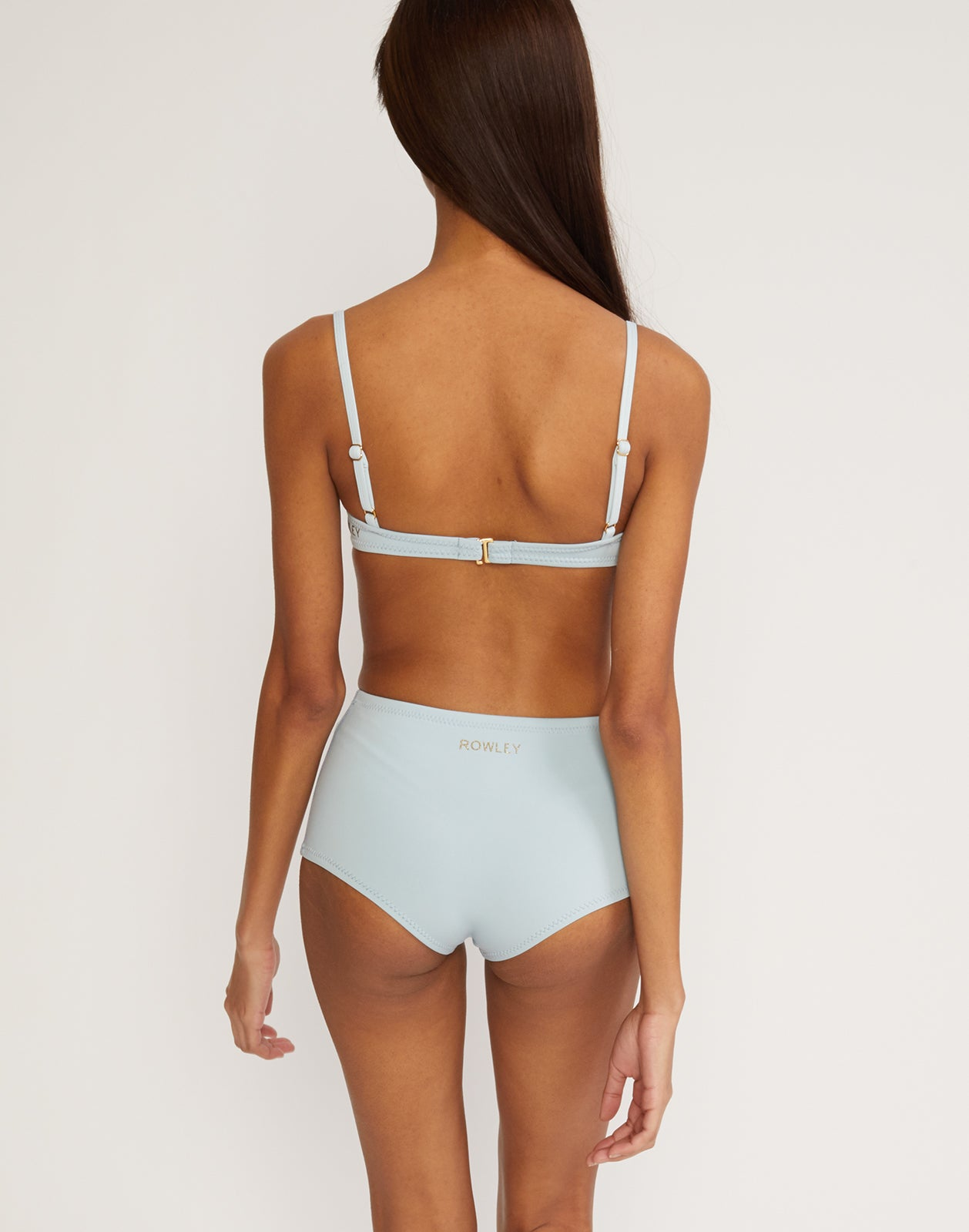 Back view of the high waisted neoprene bikini bottom.