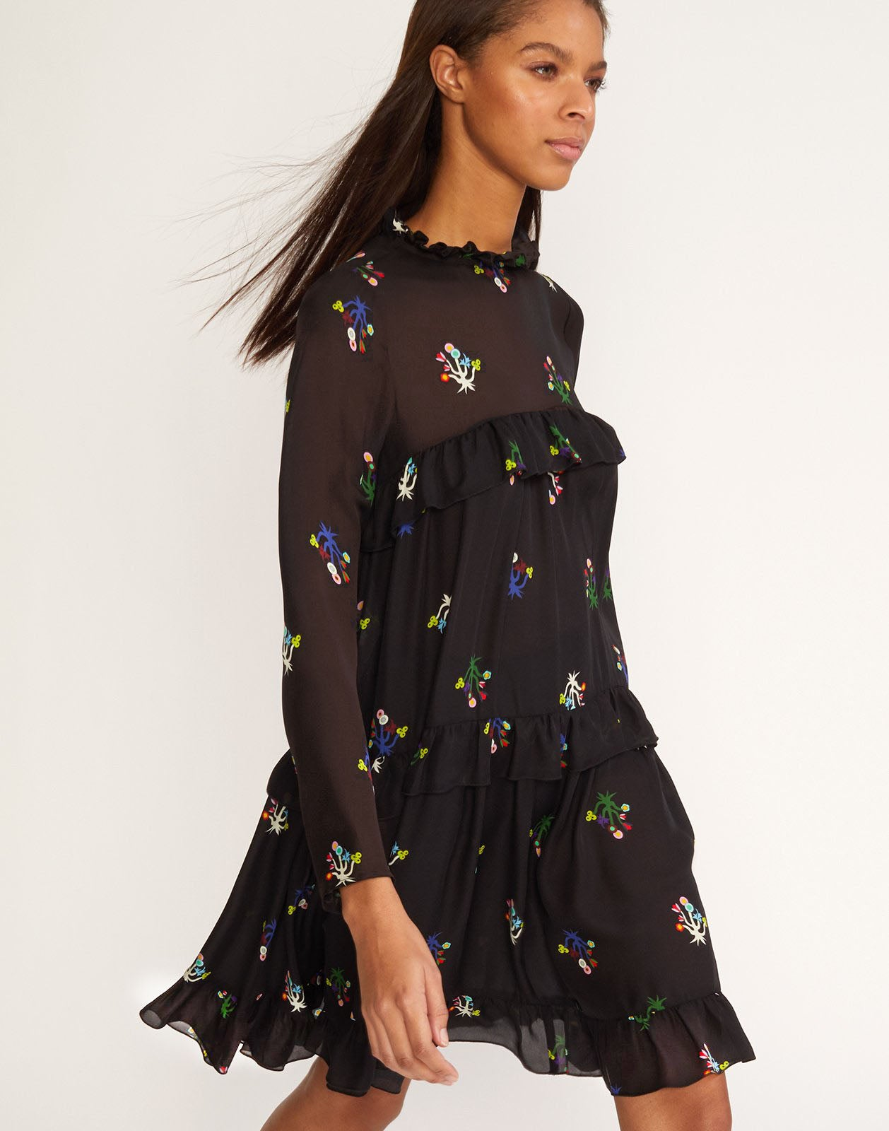 Close side view of tiered ruffle dress in floral printed silk.
