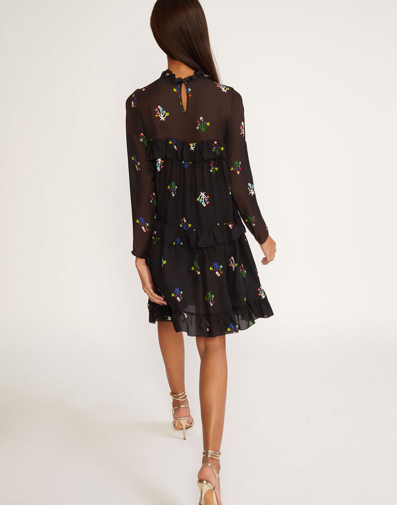 Back view of tiered ruffle dress in floral printed silk.