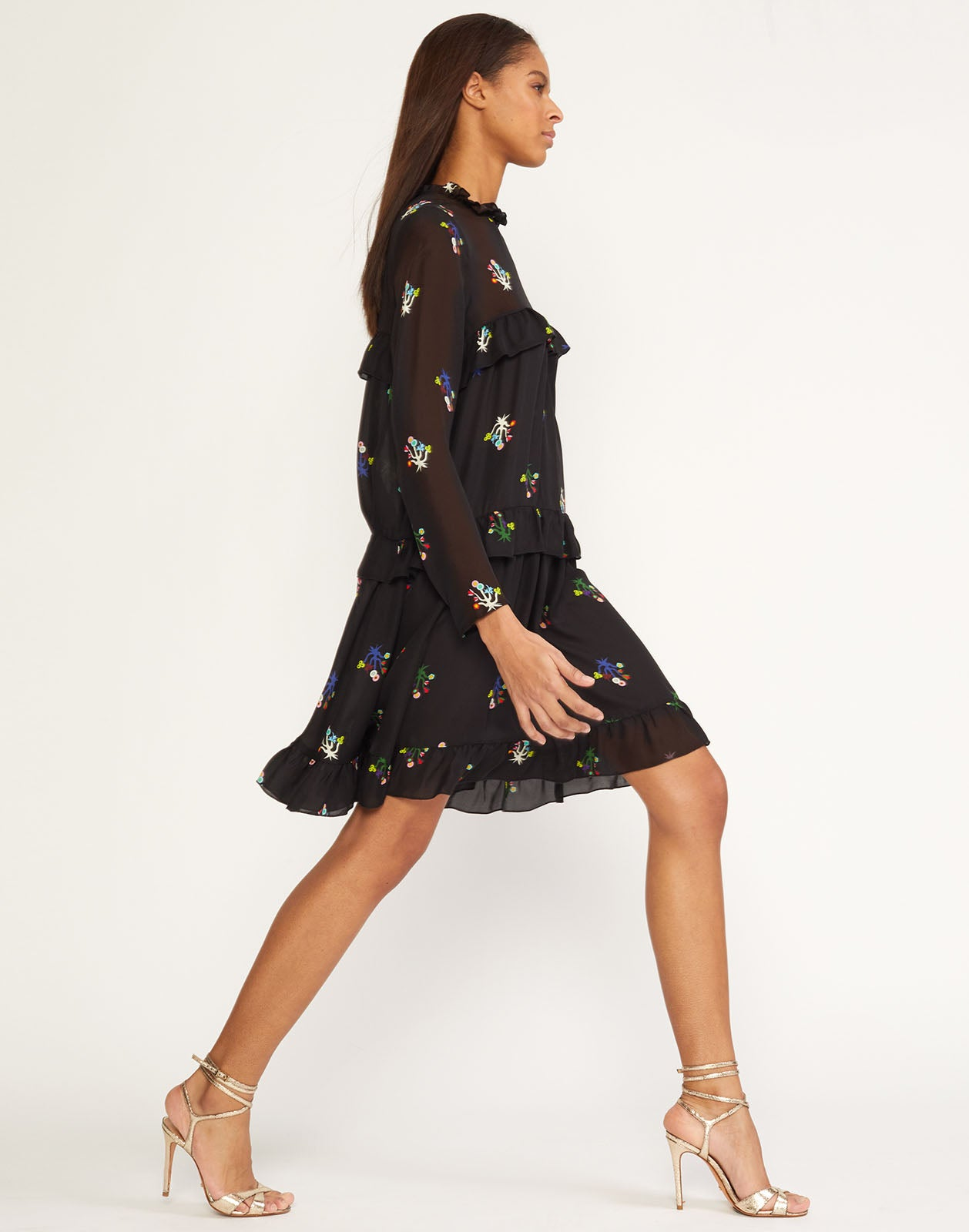 Side view of tiered ruffle dress in floral printed silk.