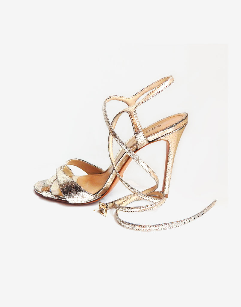 Product image of gold metallic stiletto heels with ankle straps