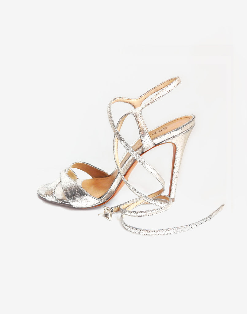 Product image of leather stiletto shoe with ankle straps in silver.