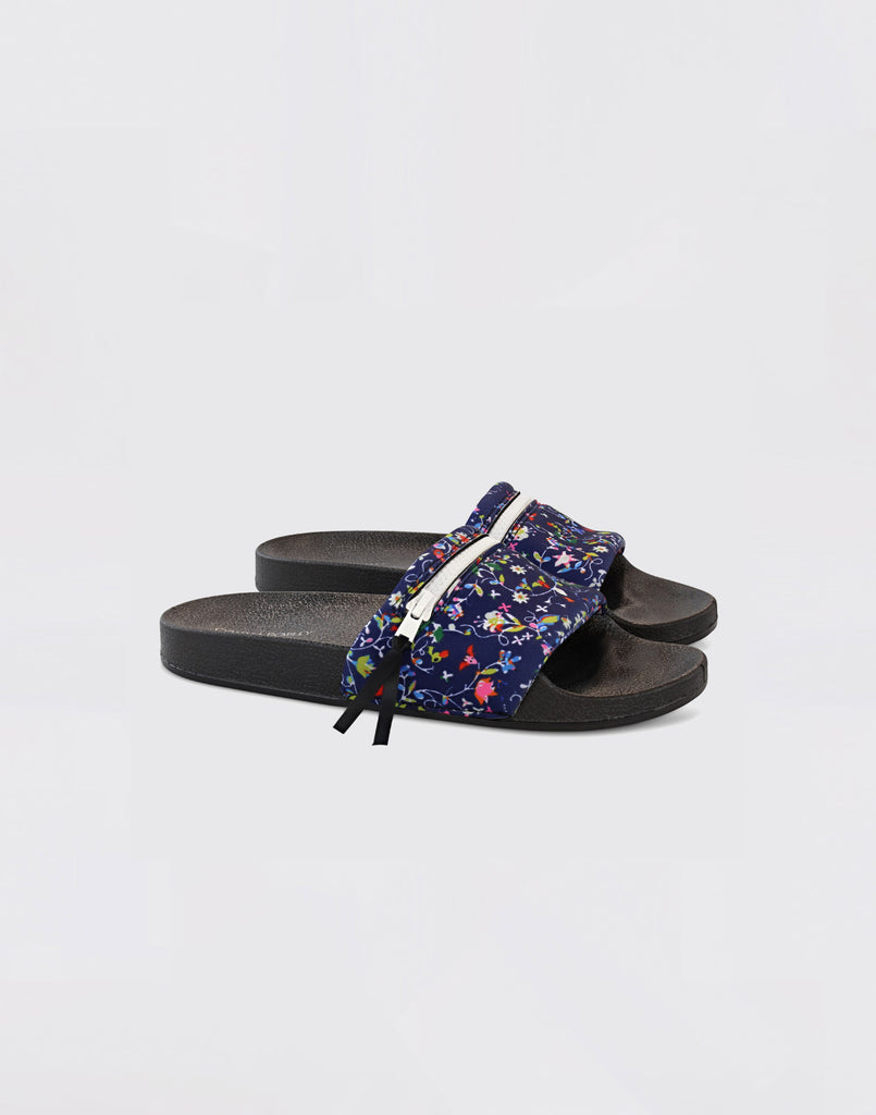 Side view of CRxBandier floral neoprene slides.
