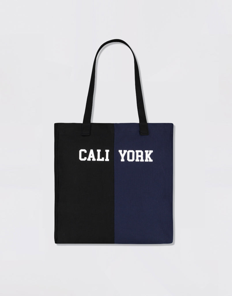 Product image of CaliYork tote in half navy, half black.