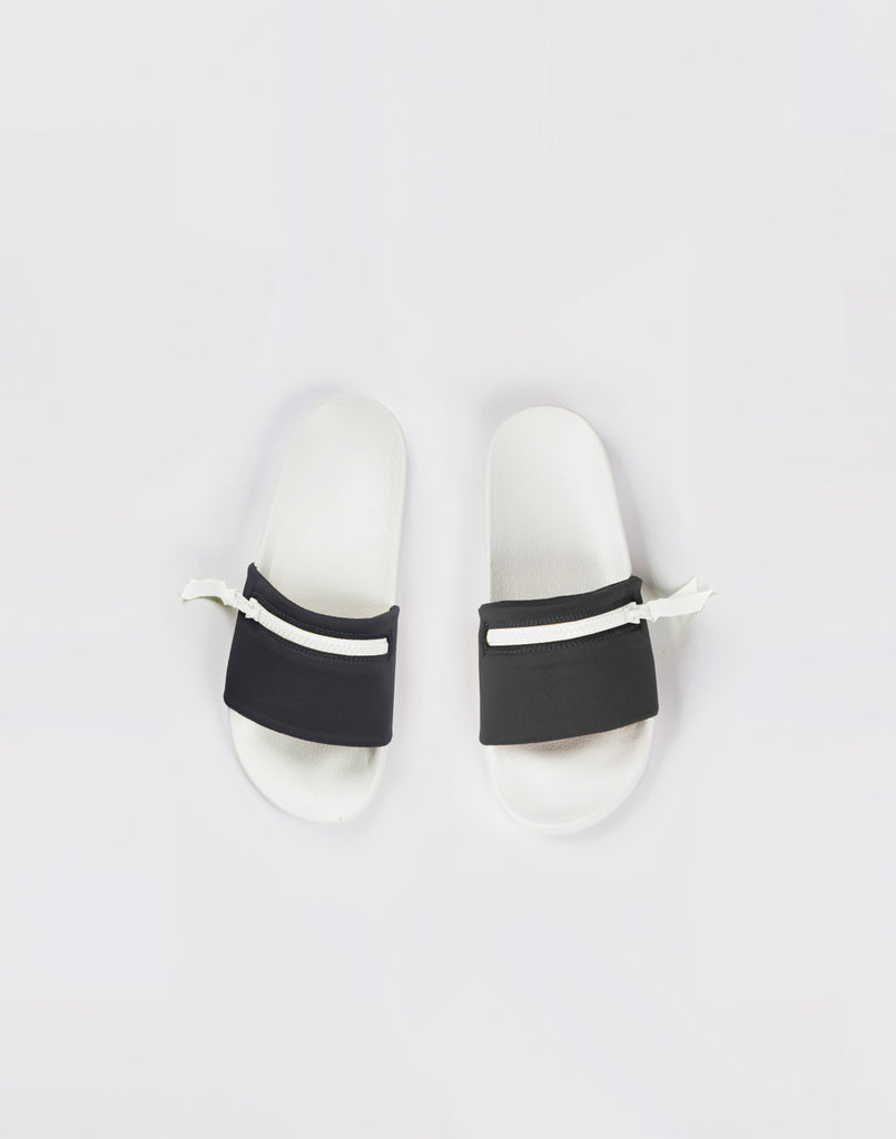 Black neoprene pool slide sandals with zipper.