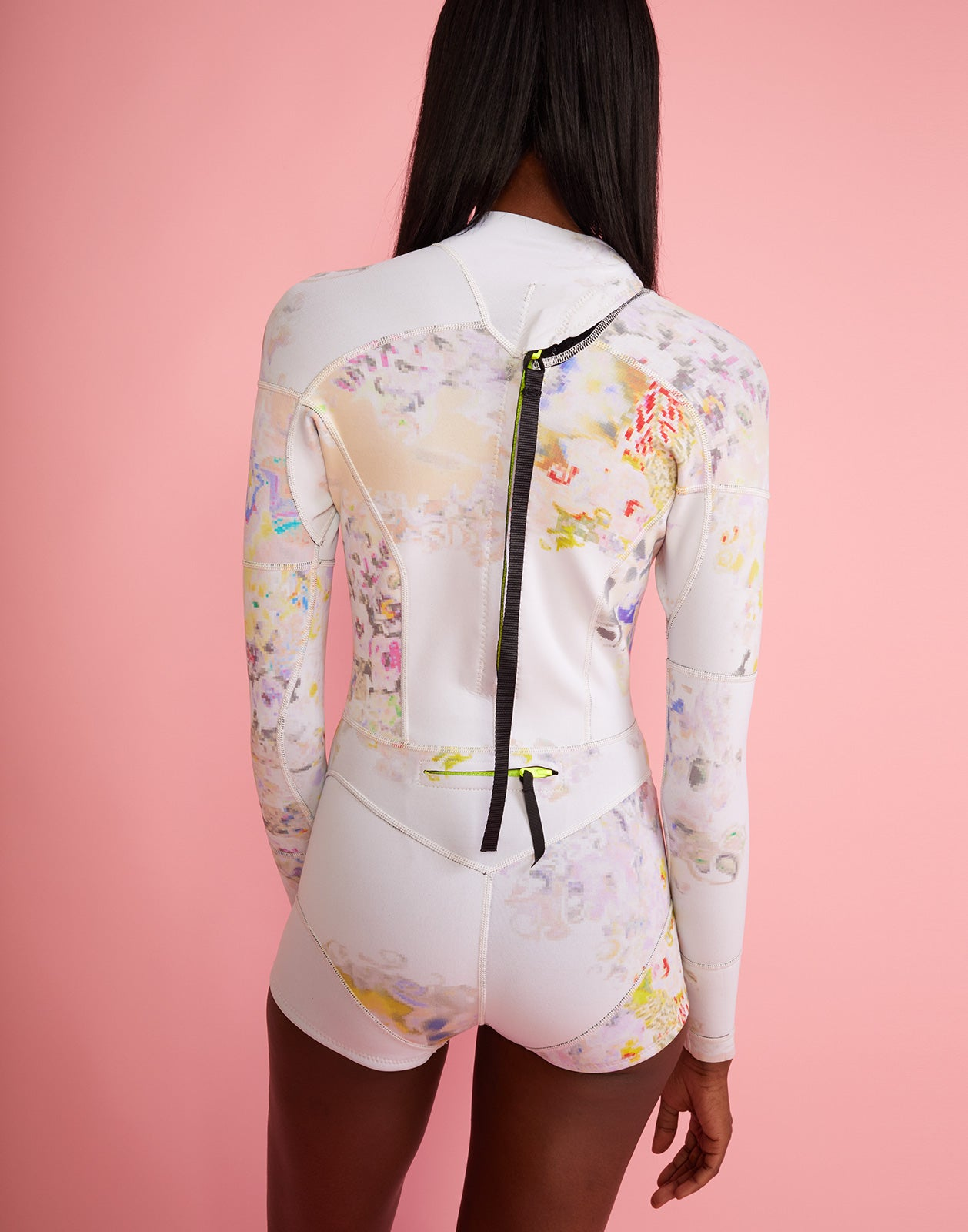 Back view of full performance neoprene wetsuit in pastel floral print.