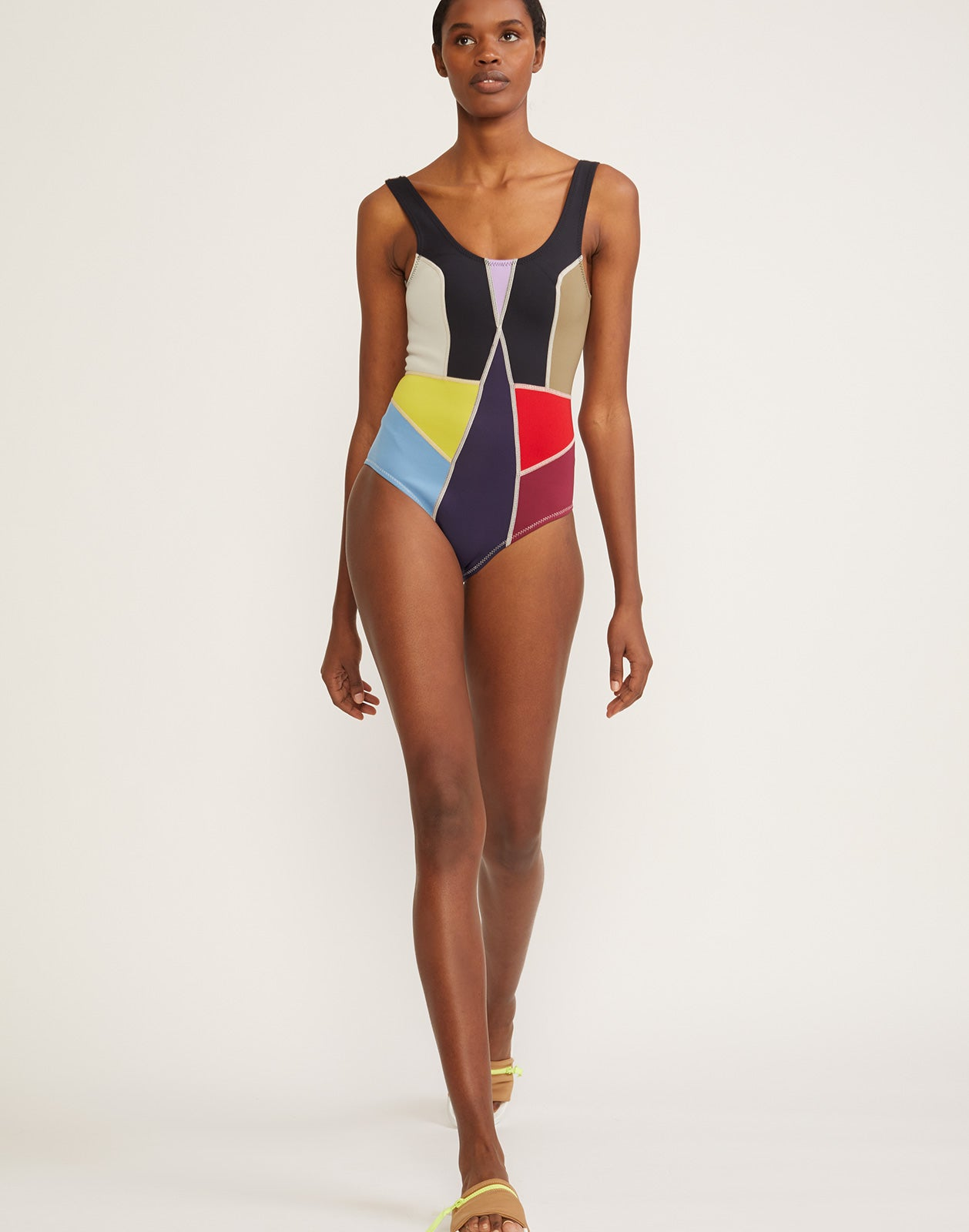 6ce59c523b Full front view of multi-color asymmetrical colorblock swimsuit.