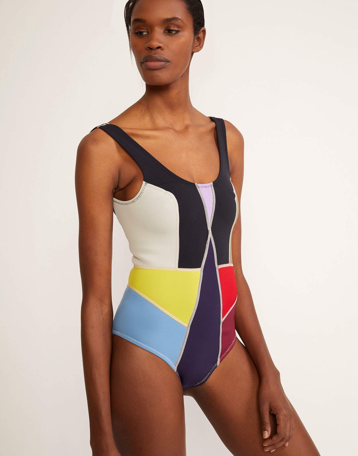 0a4c3bccb0 Three quarter view of multi-color asymmetrical colorblock swimsuit.