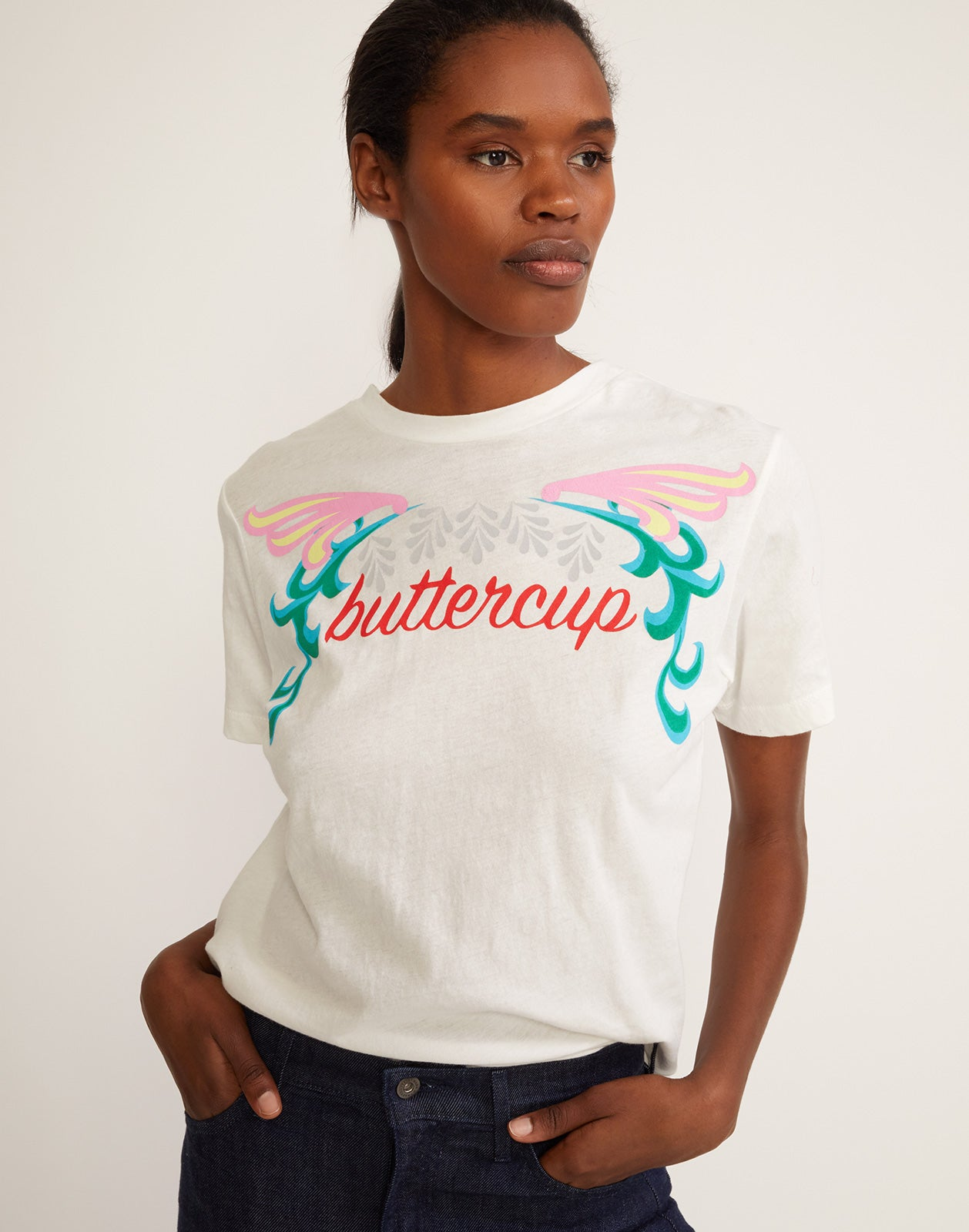 Close view of white tee with 'buttercup' printed across the front.