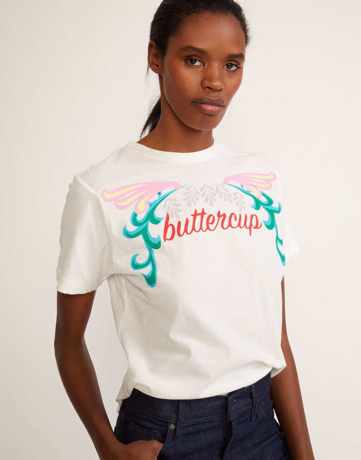 Soft white crewneck tee with buttercup printed across the front.