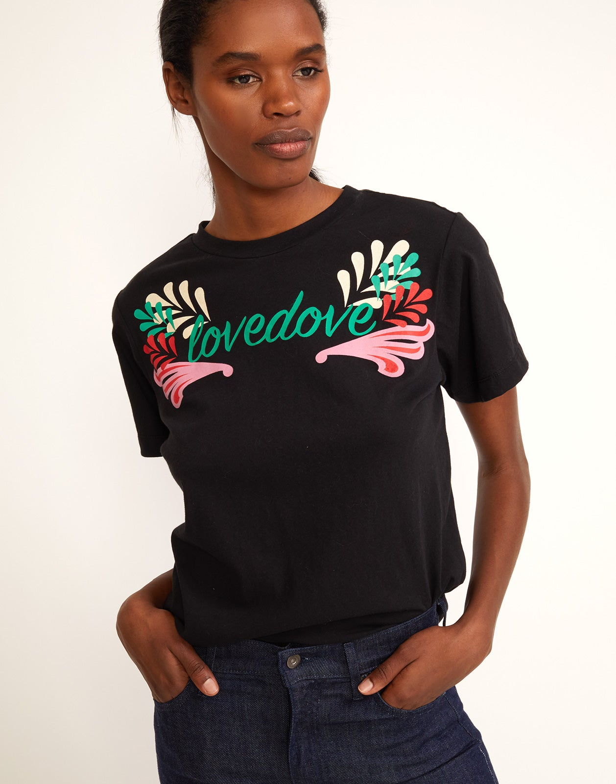 Front view of model wearing the 'lovedove' printed tee in black.