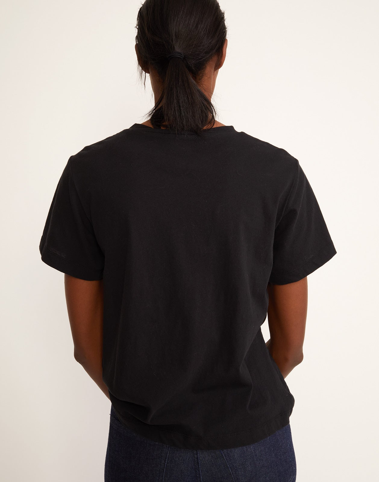 Back view of 'lovedove' printed tee in black.