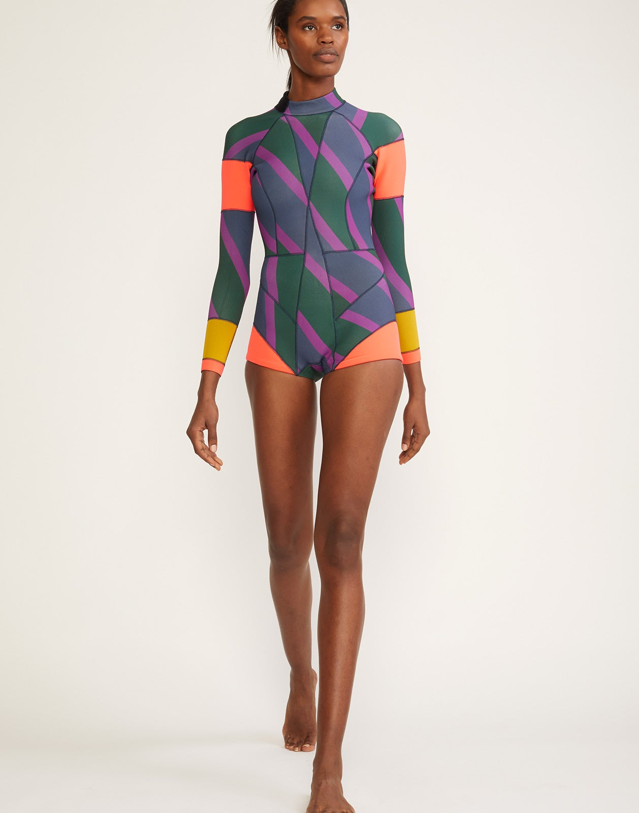 Full front view of the 2mm Neoprene wetsuit with multi color zig-zag stripes and bright colorblock panels.
