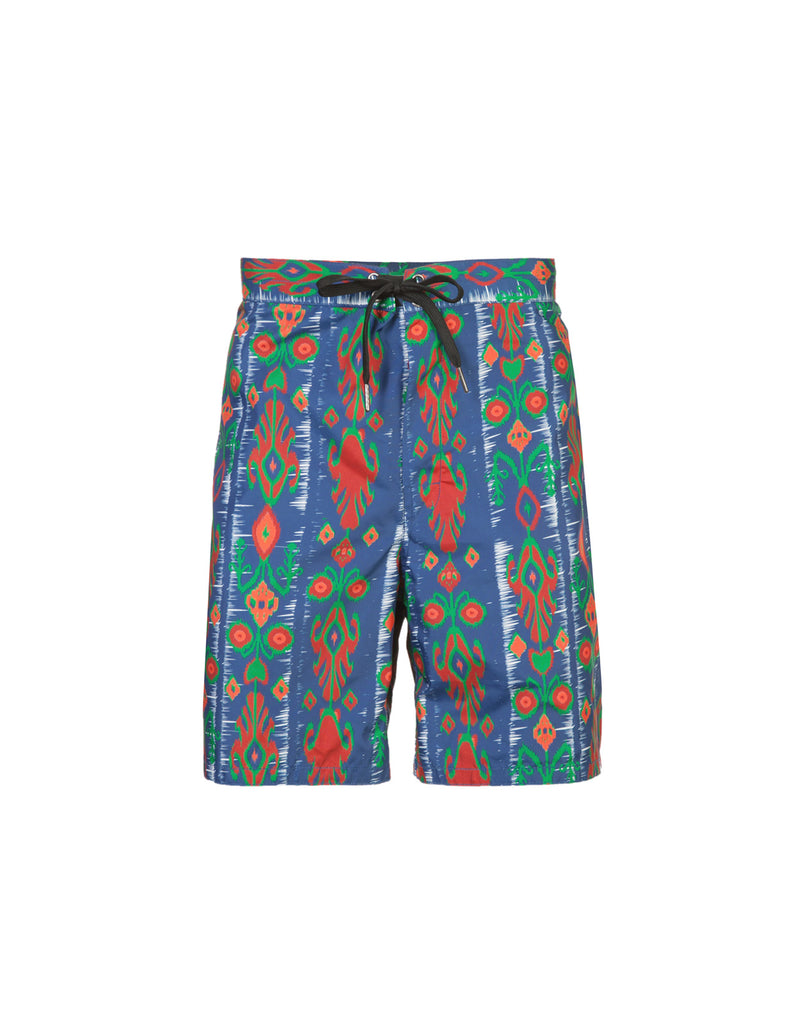 Product image of board shorts in abstract Aztec inspired print.