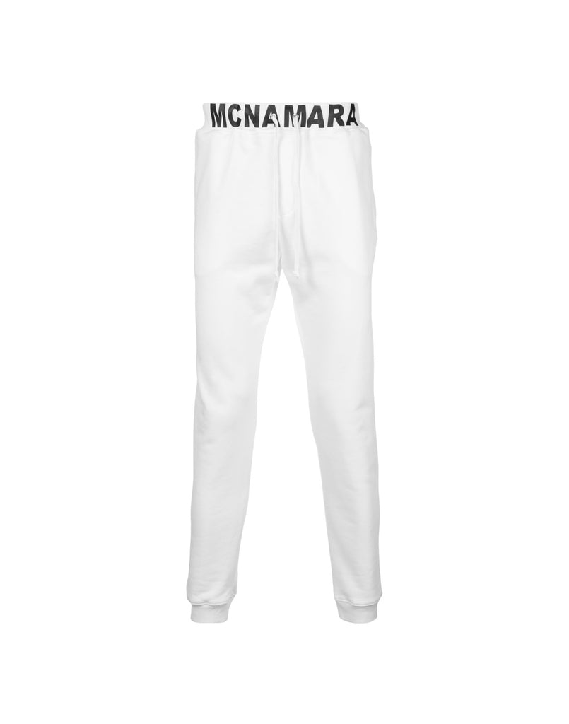 White jogger pants with MCNAMARA waistband.