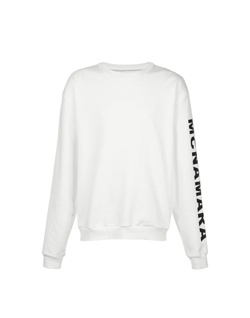 White crewneck sweatshirt with MCNAMARA printed down one sleeve.
