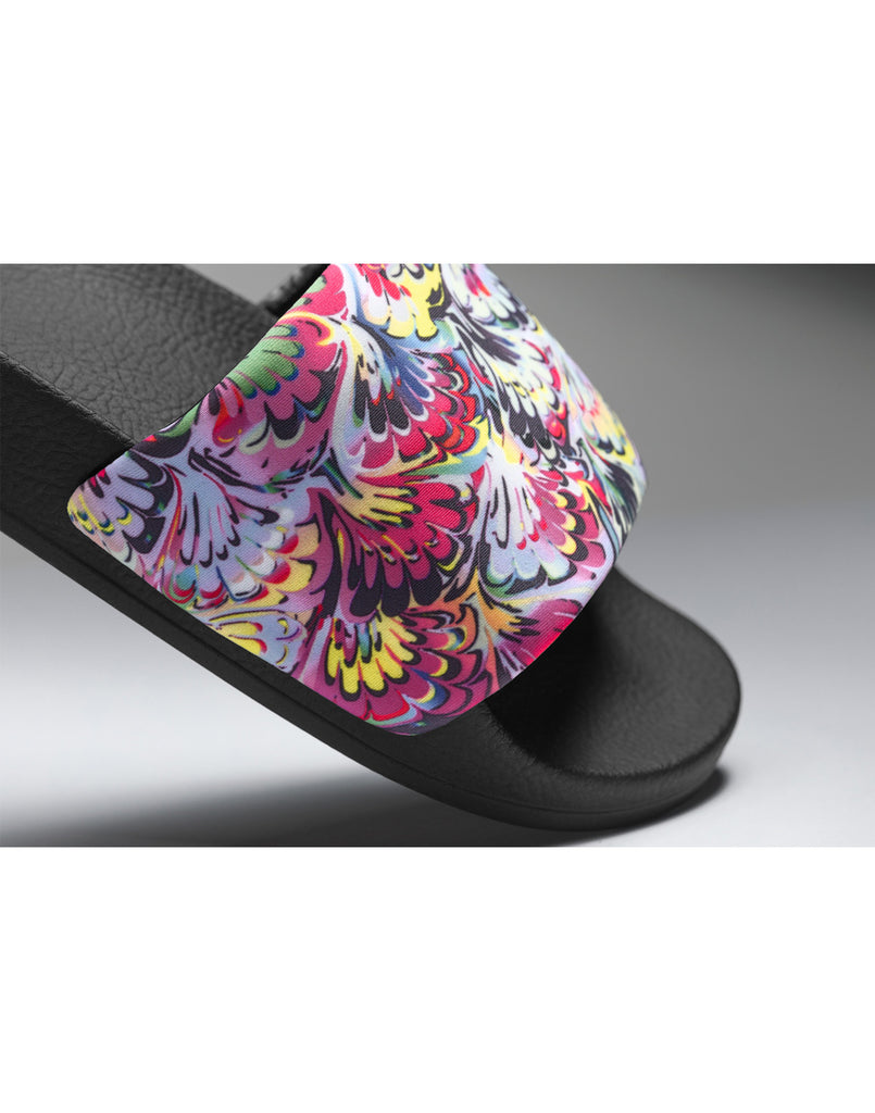 Close detail view of neoprene slip-on sandal in vibrant marble print.