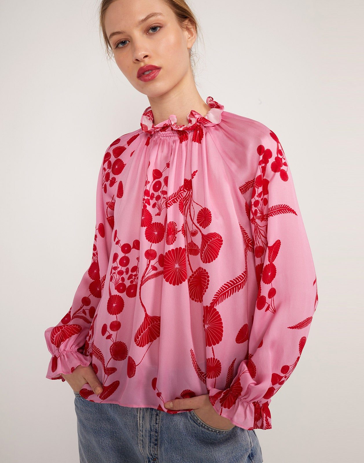 Alternate full view of model wearing Poppy Smocked Ruffle Top.