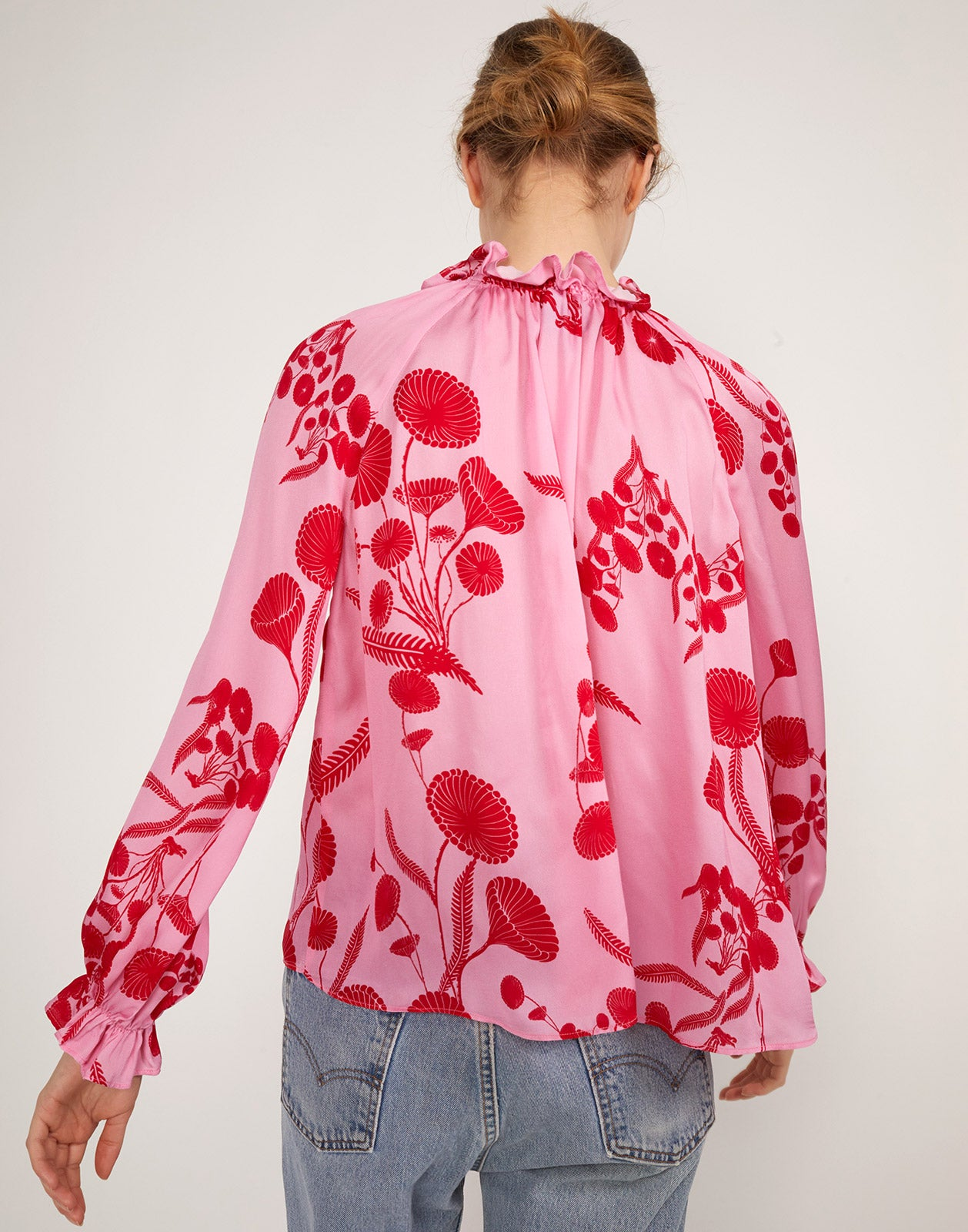 Full back view of model wearing Poppy Smocked Ruffle Top.