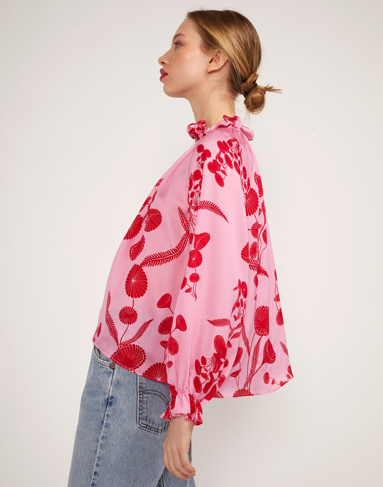 Full close up side view of model wearing Poppy Smocked Ruffle Top.