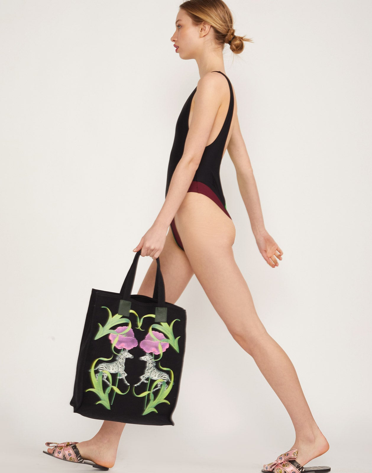 Alternate side view of model wearing Heather Swimsuit