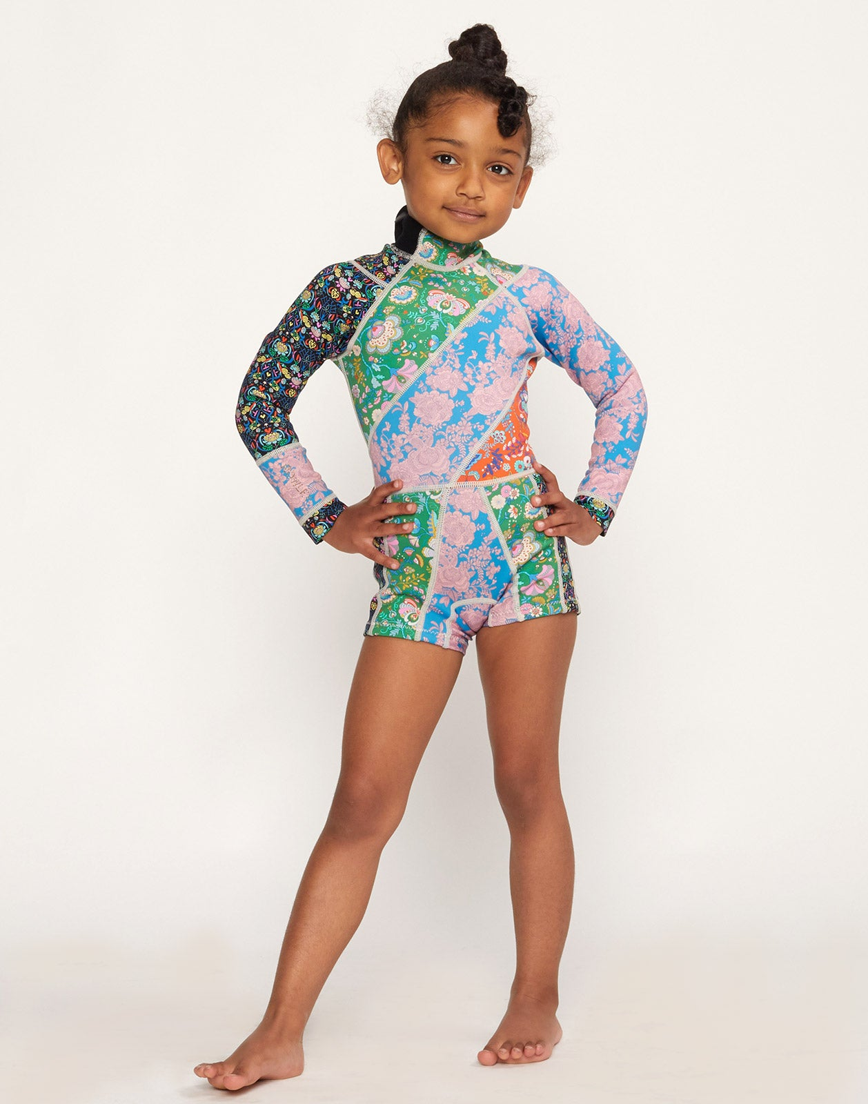 Full view of model wearing Girl's Floral Wetsuit.