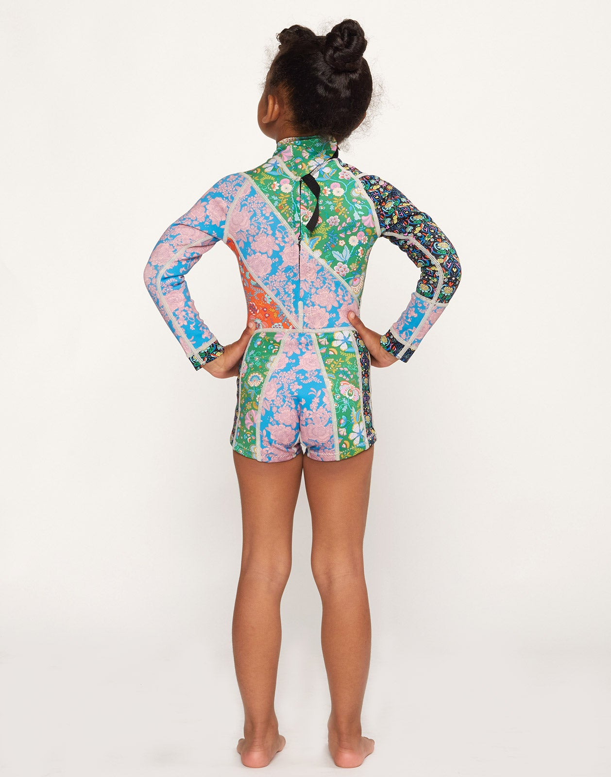 Full back view of model wearing Girl's Floral Wetsuit.