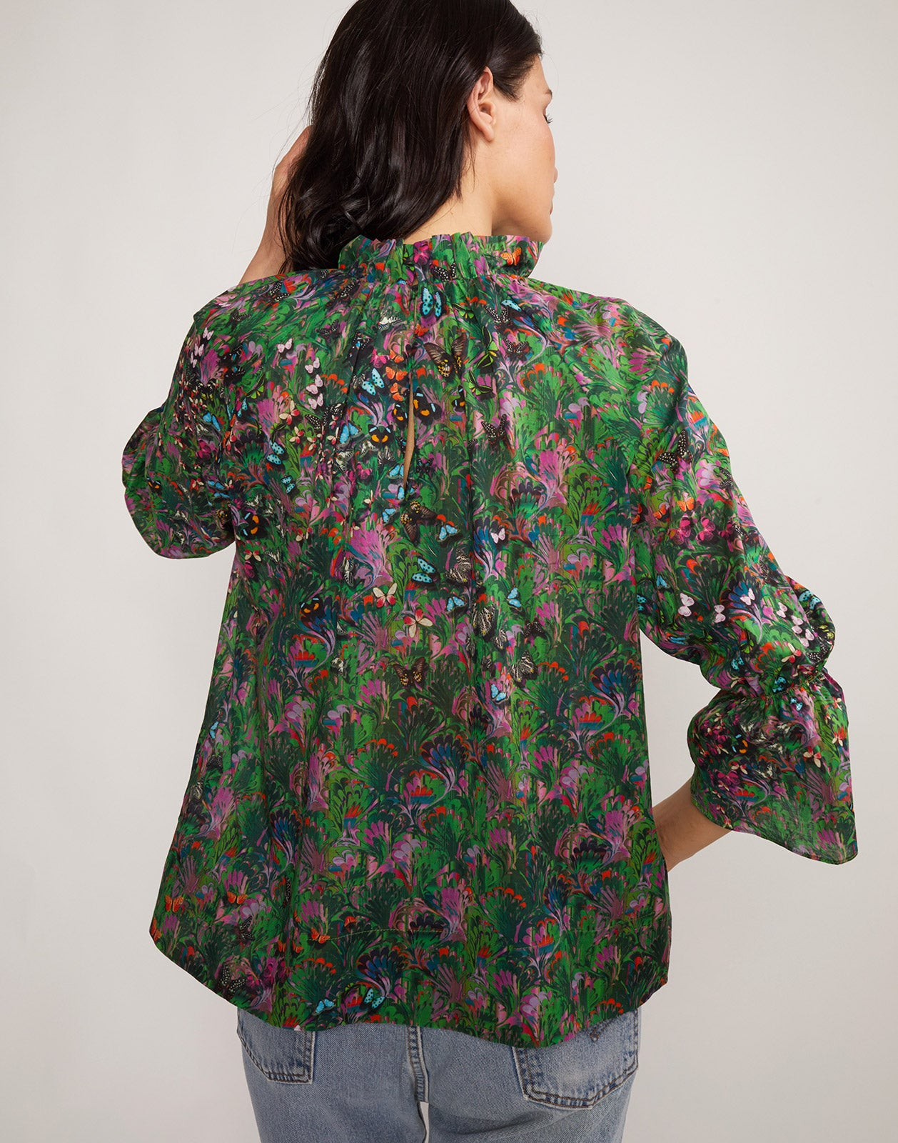 Close up back view of model wearing Butterfly Cotton Waterfall Blouse.