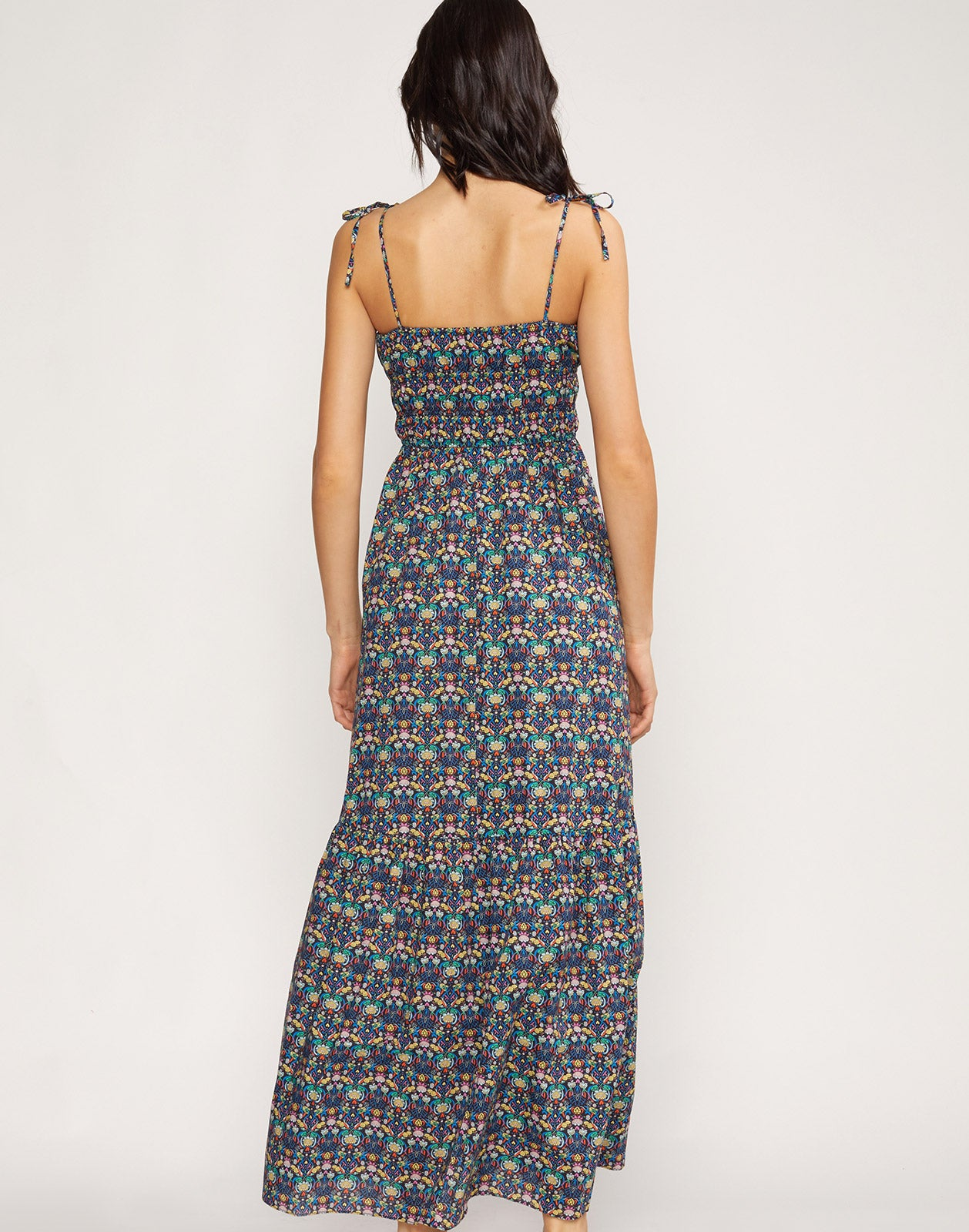 Full back view of model wearing Azores Smocked Maxi Dress.