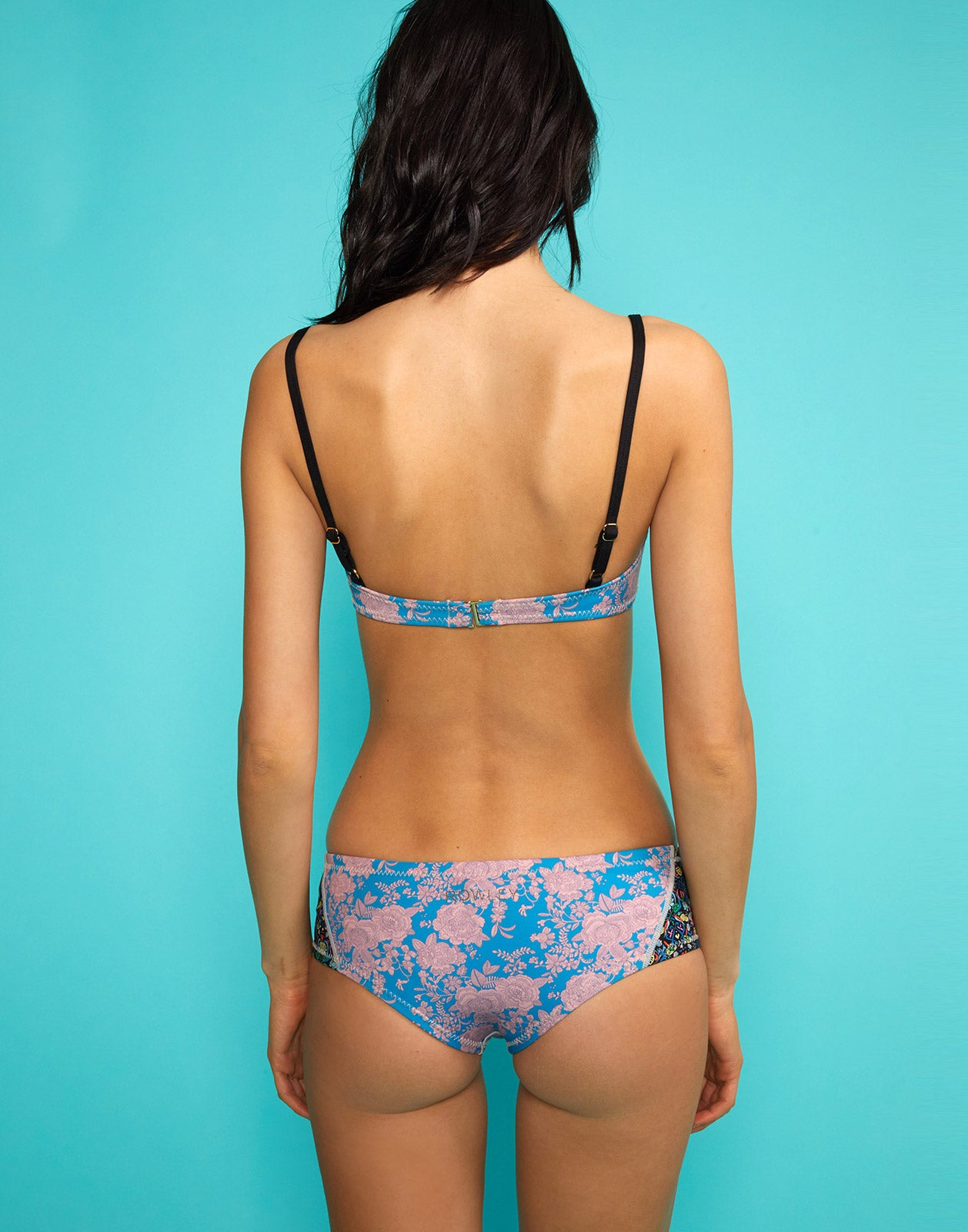 Back view of model wearing London Floral Bikini Top with London Floral Bikini Bottom.