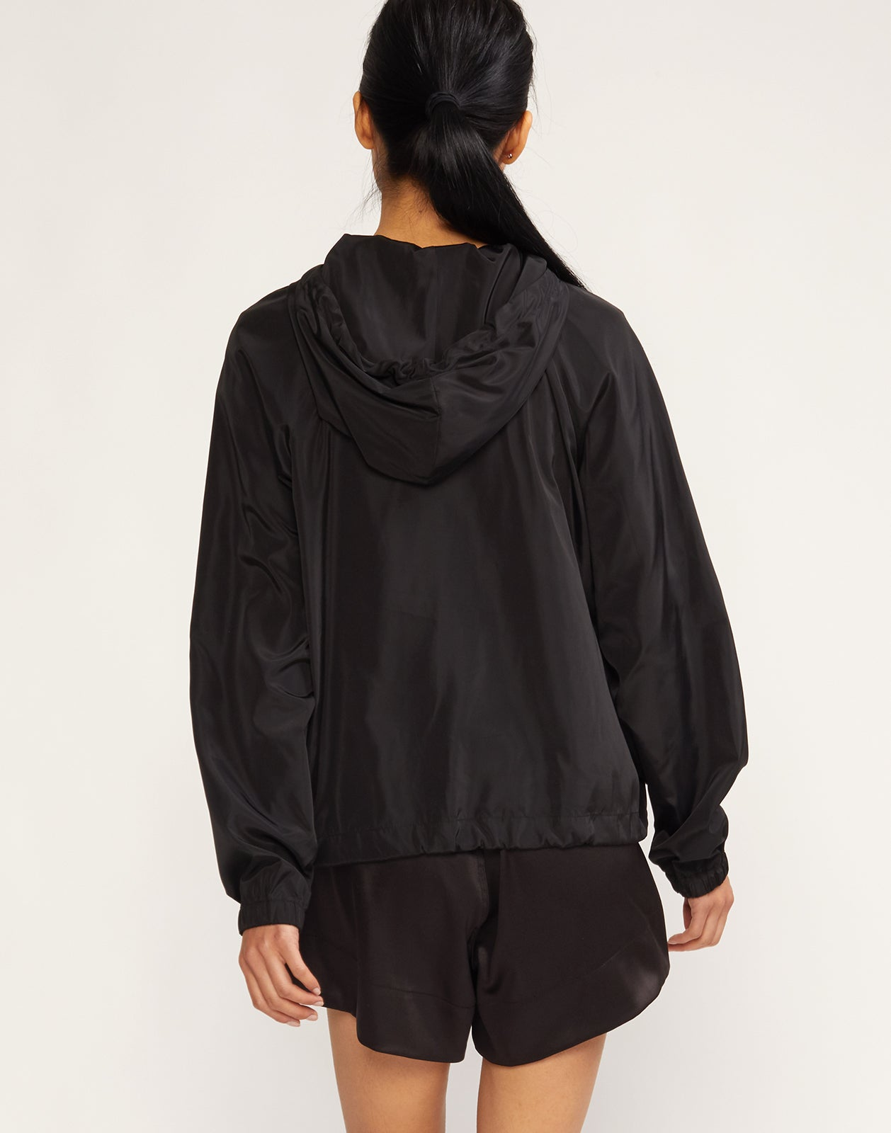 Back view of lightweight nylon striped colorblock windbreaker.
