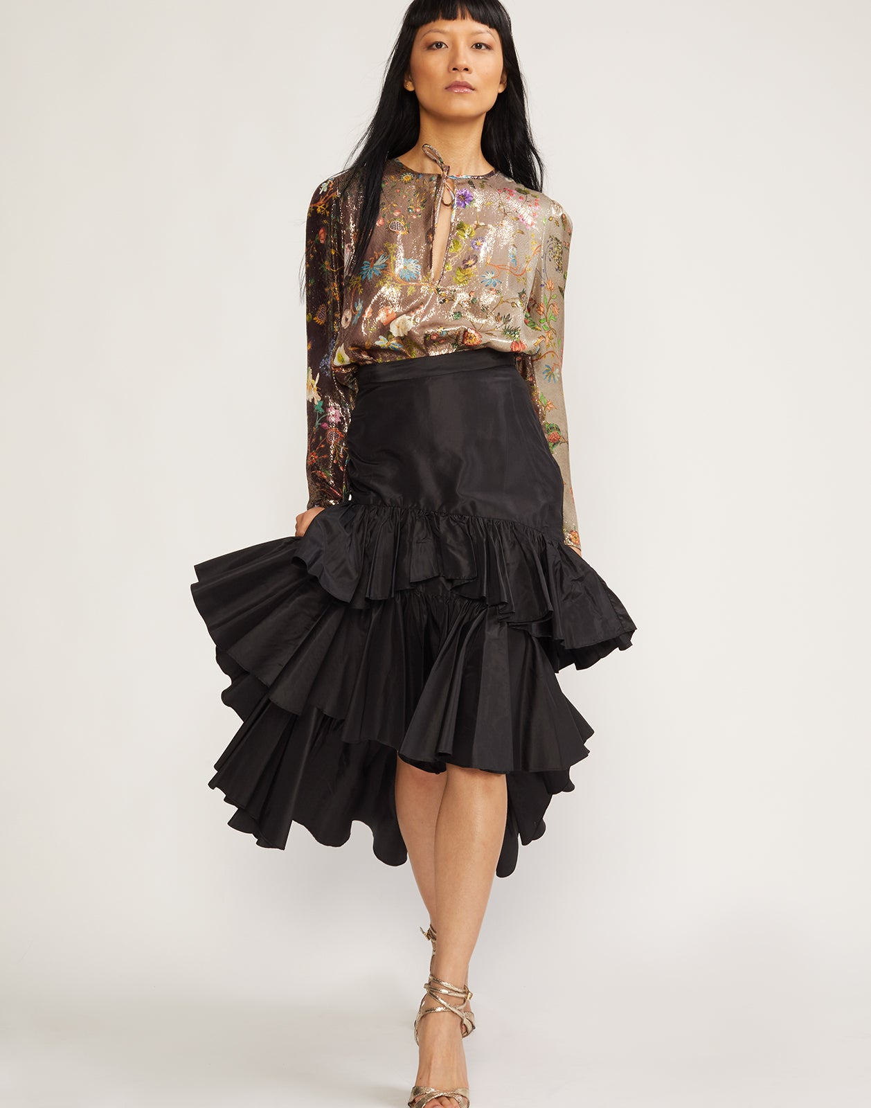 Front view of model wearing the Camila tiered ruffle skirt in black.