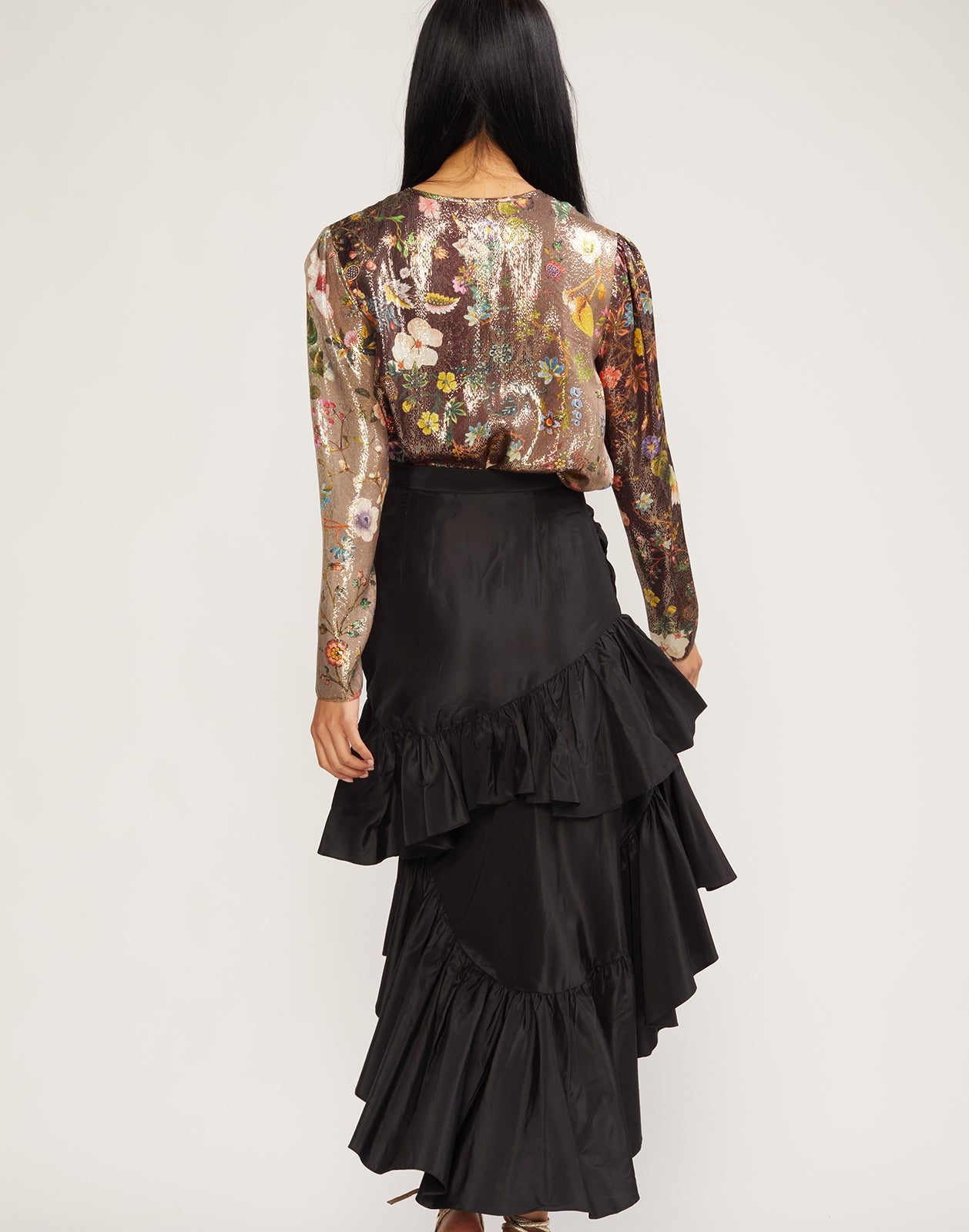 Back view of the Camila tiered ruffle skirt in black silk taffeta.