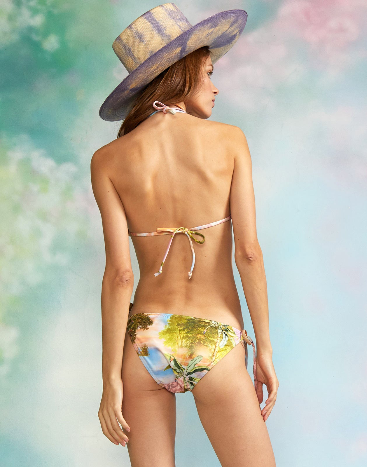 Back view of model wearing the Pink Seascape Bikini Top with the Pink Seascape Bikini Bottom.