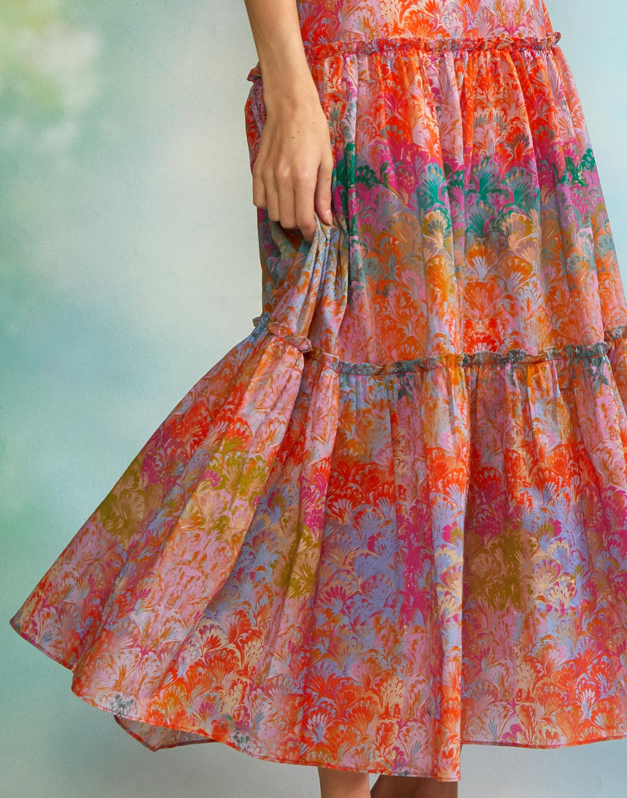 Close view of sunset marble print maxi skirt with tiered detail