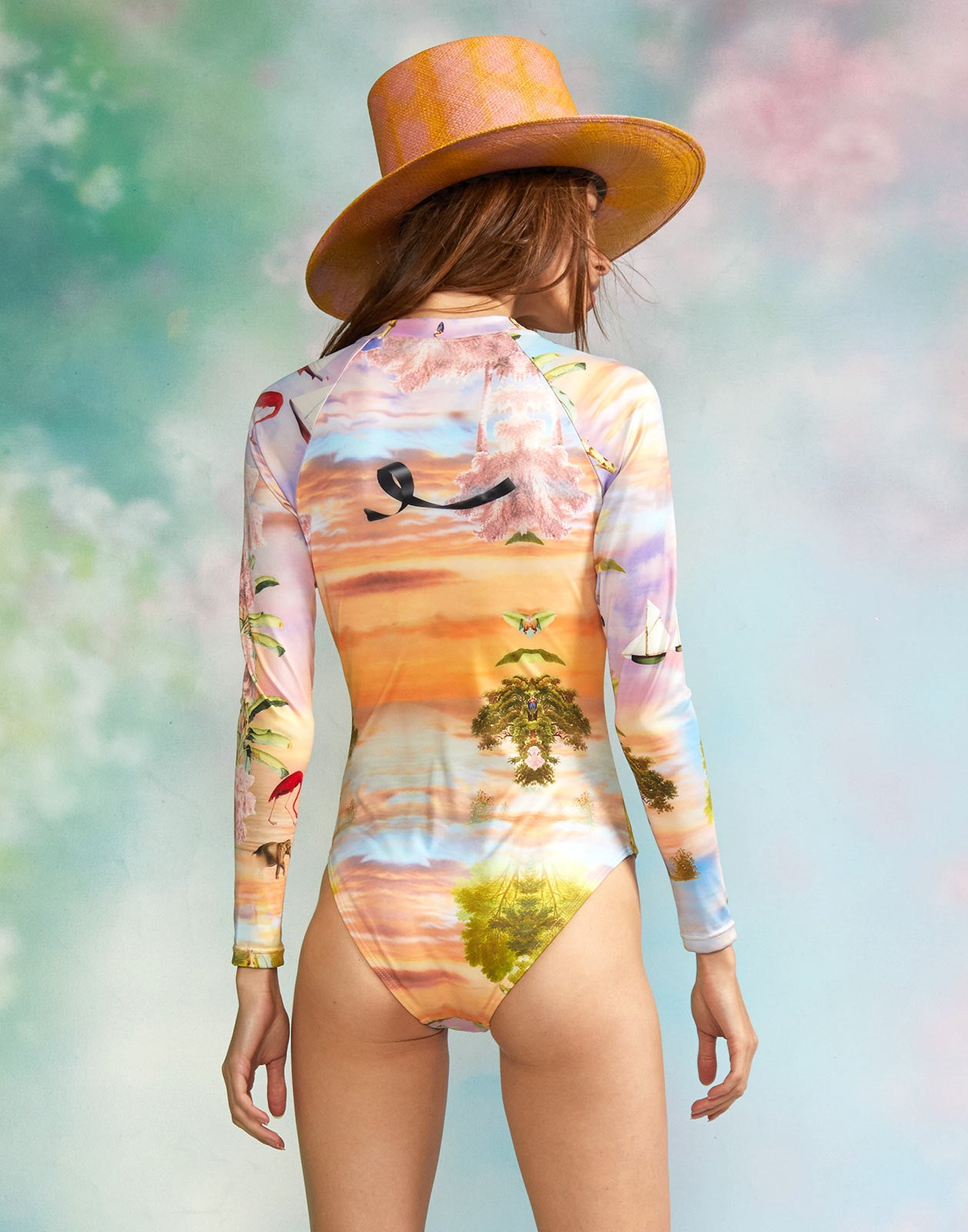 Back view of model wearing the Paradise Surfsuit.