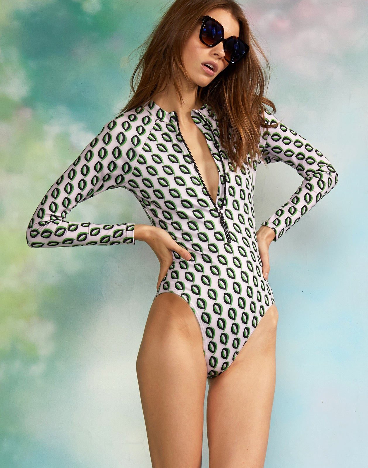 Side view of model wearing the Riva Surfsuit.
