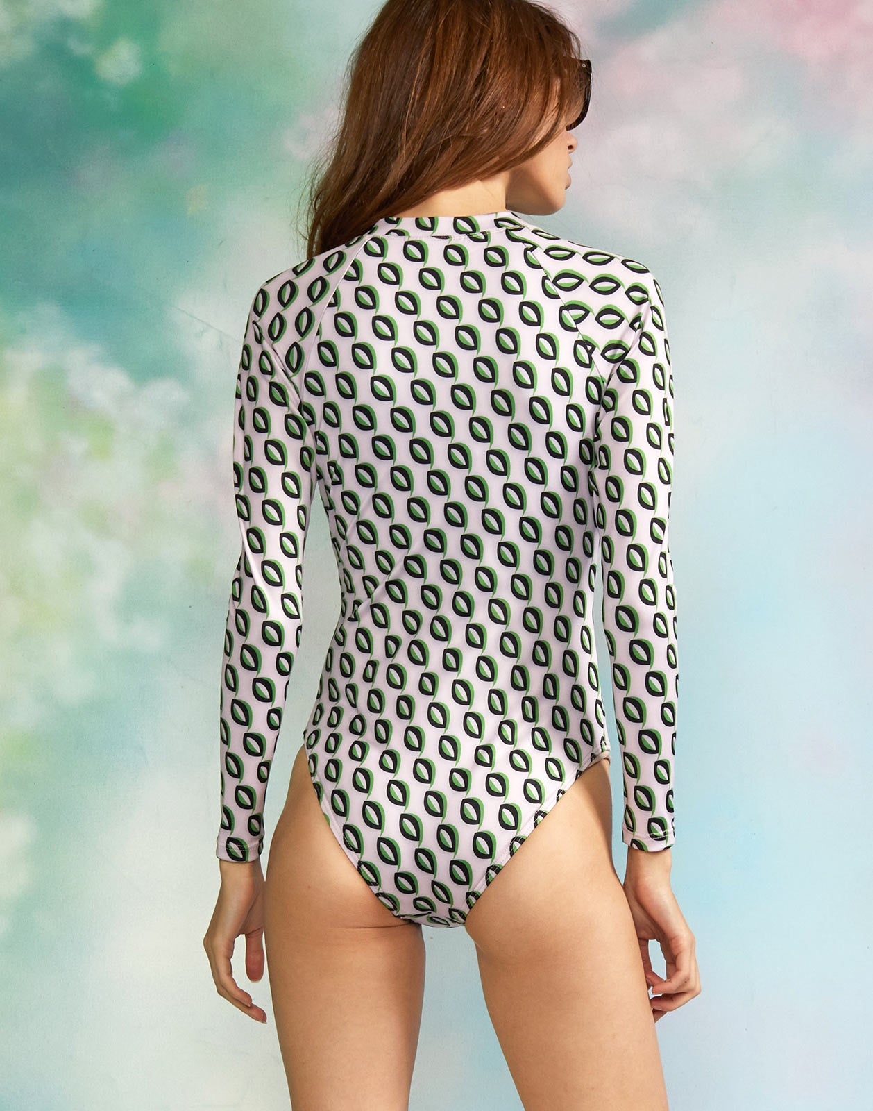 Back view of model wearing the Riva Surfsuit.