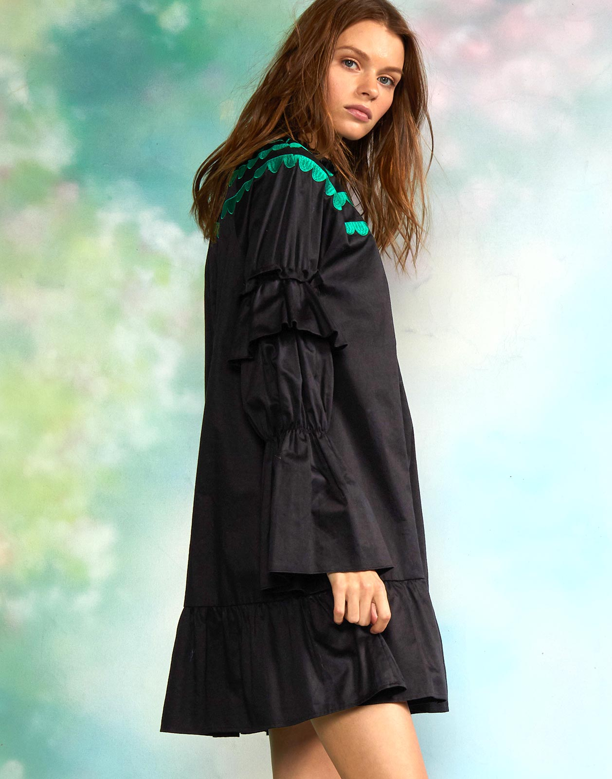 Side view of swing dress with long bell sleeves