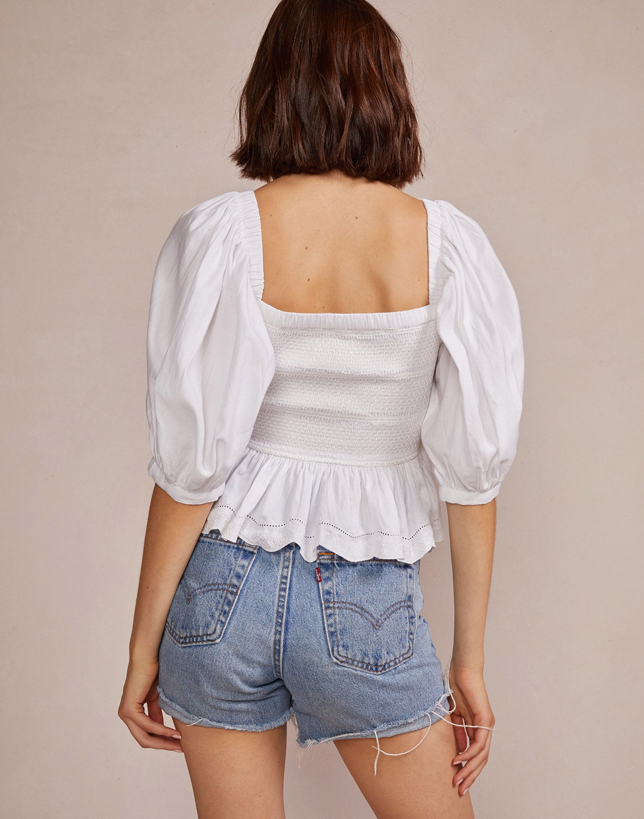 Alternate back view model wearing Lily Smocked Top